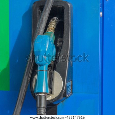 Fuel nozzle at a gas station.