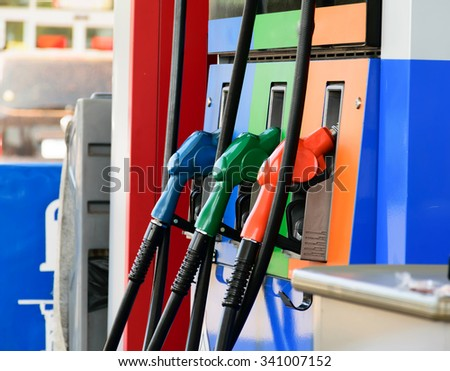 Fuel nozzle on gas station,beautiful fuel nozzle,fuel nozzle for refueling the car,Fuel nozzle  - stock photo