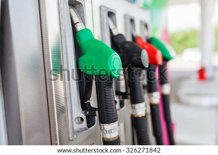 fuel pumps at a gas station. - stock photo