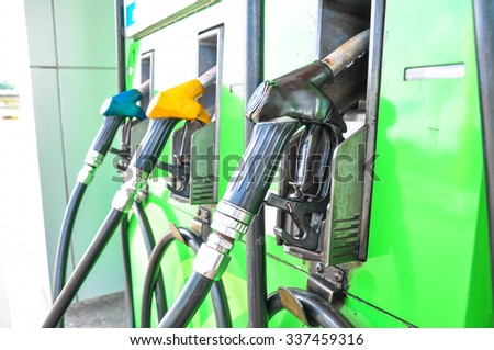fuel pumps at a gas station - stock photo