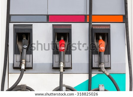 Fuel pumps petrol ,Three refuel nozzles in gas station - stock photo
