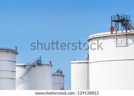 Fuel storage in white tanks in a distribution warehouse - stock photo