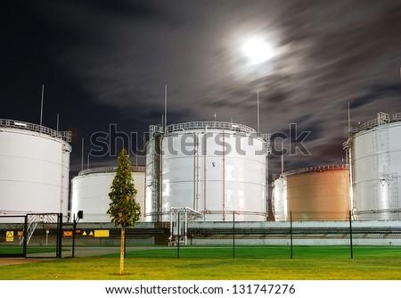 Fuel storage tanks at oil terminal - stock photo