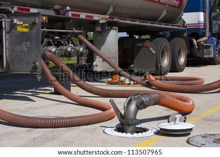 Fuel tanker diesel pumping fuel into filling station underground tank