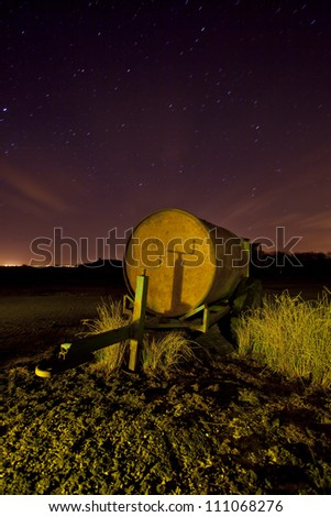 fuel trailer at night under a stary sky - stock photo