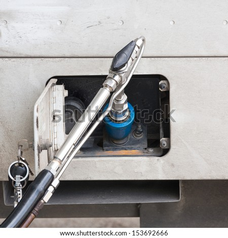 Fuel up the natural gas vehicle (NGV) - stock photo