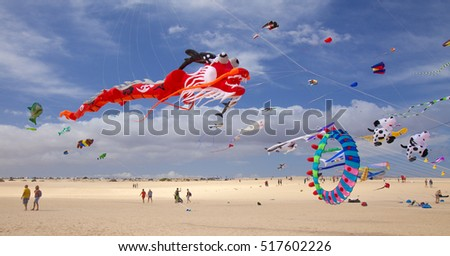 FUERTEVENTURA, SPAIN - NOVEMBER 11: Viewers watch from the ground as colorful kites fill the sky at 29th International Kite Festival, November 11, 2016 in Dunes of Corralejo, Fuerteventura, Spain