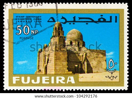 "FUJEIRA - CIRCA 1966: A stamp printed in Fujeira (UAE) shows First Christian church with inscription and name of the series ""Stamp Centenary Exhibition, Cairo, January 1966"", circa 1966"