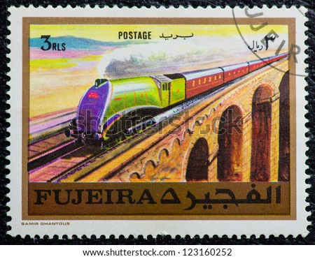 FUJEIRA - CIRCA 1971: A stamp printed in the FUJEIRA, showing a streamlined steam locomotive, circa 1971 - stock photo