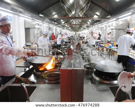 Genial Group Of Chefs Working Together In A Chinese Restaurant