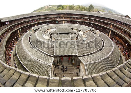 Fujian Tulou house in China. It is the Chinese rural dwellings of the Hakka and others in the mountainous areas in southeastern Fujian, China. - stock photo