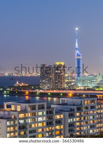 Fukuoka City, Kyushu, Japan, Beautiful Panorama Aerial Night View cityscape of Seaside Momochi, Hakata Downtown CBD and Fukuoka Tower at twilight summer with Light Trails