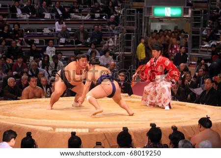 FUKUOKA, JAPAN - NOVEMBER 19: Unidentified  Sumo wrestlers ready to engage in the arena of the Fukuoka Tournament on November 19, 2010 in Fukuoka, Japan. - stock photo
