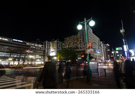 FUKUOKA - MARCH 9: Billboards in front of Hakata station March 9, 2015 in Fukuoka, JP. The area is busy in rush hour.
