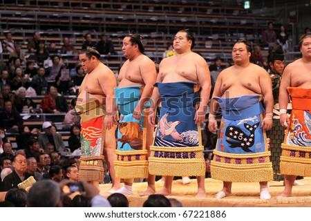 FUKUOKA - NOVEMBER 18: Highest ranking sumo wrestlers entering the arena in the Fukuoka Tournament on November 18, 2010 in Fukuoka, Japan. - stock photo