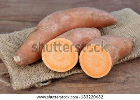 full and half sweet potato on the table - stock photo