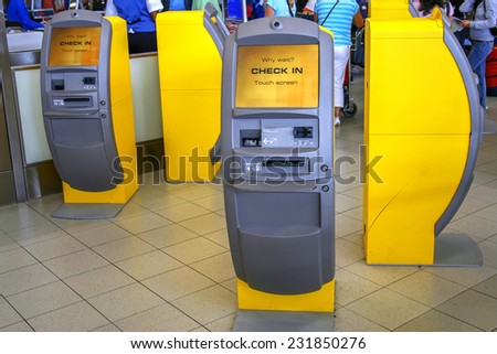 Full automatic quick check in counters at the airport  - stock photo