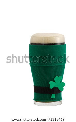 Full beer glass in green with black belt leprechaun suit for St Patrick day celebration decorated with shamrock - stock photo