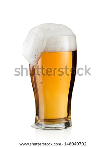 Full beer glass with froth