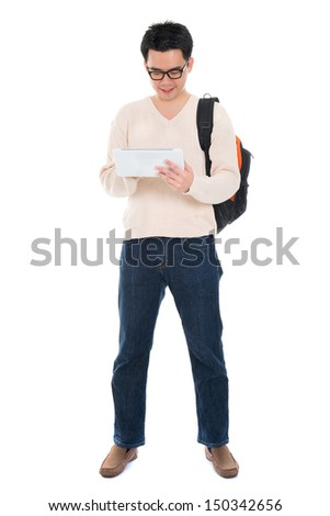 Full body Asian adult student in casual wear with school bag using digital computer tablet pc standing isolated on white background. Asian male model. - stock photo