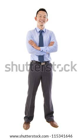 Full body Asian business man in blue shirt standing over white background - stock photo