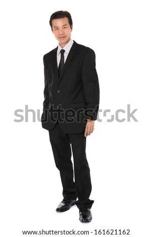 Full body  Asian executive standing against isolated white background