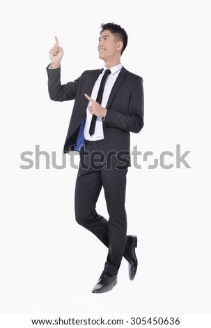 Full body Asian young business man showing pointing up,  - stock photo