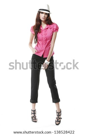 Full body attractive brunette and black tights wearing a hat - stock photo