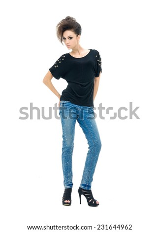 Full body beautiful woman in jeans posing in studio