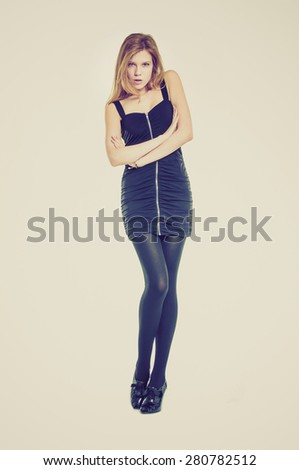 Full body beautiful young girl with black dress  in retro style - stock photo
