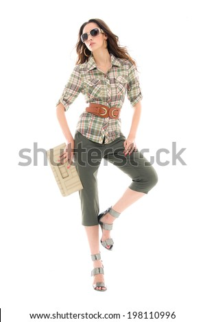 Full body beautiful young woman in sunglasses with purse posing - stock photo