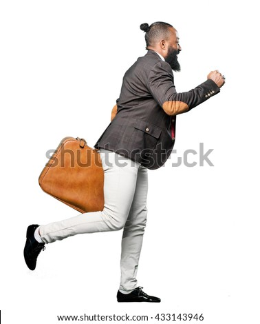 full body black man holding a leather bag - stock photo