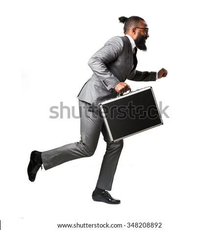 full body business black man running holding a suitcase - stock photo