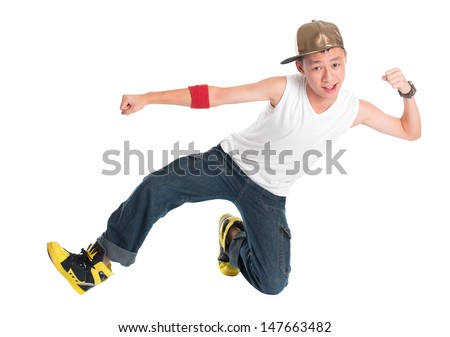 Full body cool looking Asian teen hip hop dancer dancing isolated on white background. Asian youth culture. - stock photo