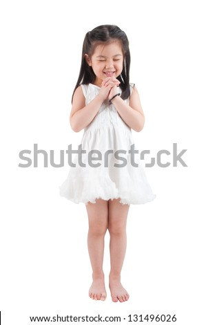 Full body East Asian girl making a wish with smiling, standing isolated on white background - stock photo