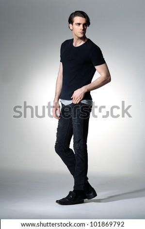 Full body fashion male profile portrait isolated on light background - stock photo