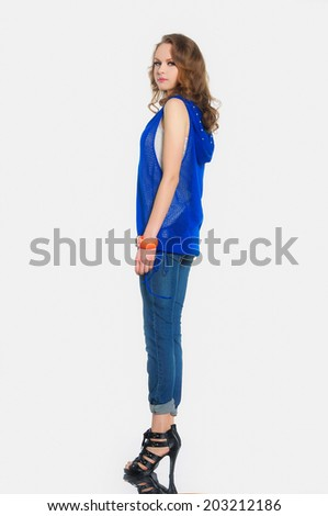 Full body Fashion model in jeans posing for the camera - stock photo