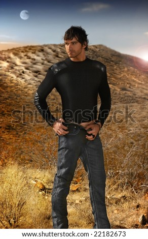 Full body fashion portrait of young good looking male model against an otherworldy background - stock photo