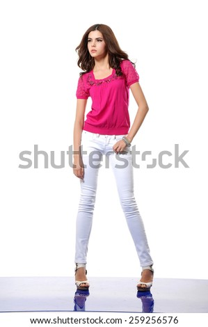Full body fashion shot of girl posing in studio - stock photo