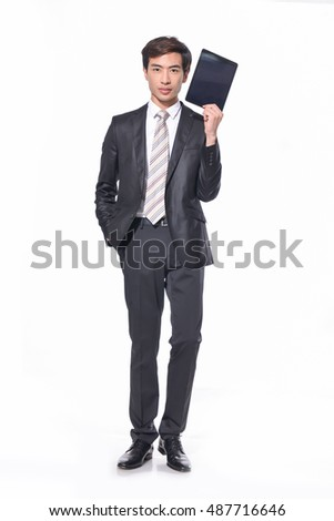 Full body Happy Young Businessman holding Digital Tablet