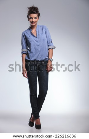 Full body image of a young sexy fashion woman posing and smiling for the camera. - stock photo