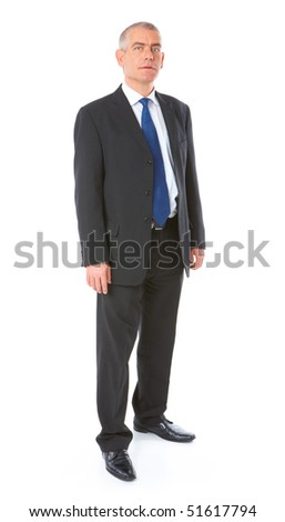 Full body image of mature standing business man wearing dark suit, isolated over white background - stock photo