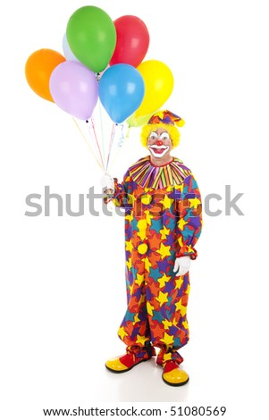 Full body isolated view of a happy clown holding a bunch of colorful balloons. - stock photo