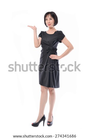 Full body Middle aged corporate woman showing copy space to the camera, - stock photo