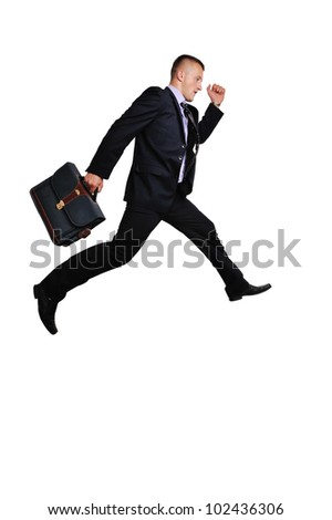 Full body of a businessman witha suitcase in a hurry over white background