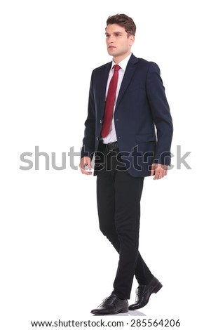 Full body of a young business man walking on isolated background. - stock photo