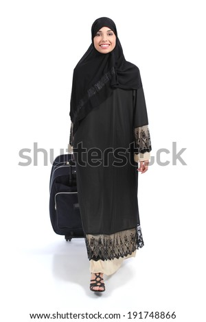 Full body of an arab saudi woman traveler walking isolated on a white background            - stock photo