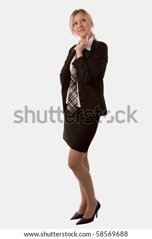 Full body of attractive blond woman with long legs wearing business suit skirt and tie standing on white with hand on chin looking up thinking - stock photo