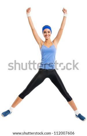 Full body of cheerful young jumping woman, isolated over white background - stock photo
