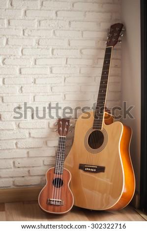 Full body of classic guitar in room - stock photo